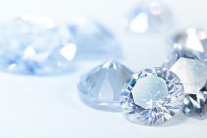 Shiny white blue diamonds on dark background